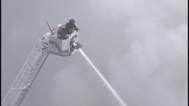 Smoke seen coming from a building fire in the 1900 block of Washington Avenue. The fire spread to 4-alarm. (News 4 Chopper)