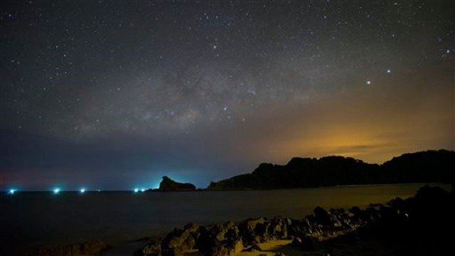 This Saturday, June 1, 2013 photo, shows Milky Way over Gem Island, east coast of Malaysia. (AP Photo/Vincent Thian)