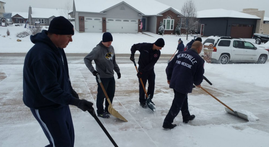 The Wentzville firefighters were shoveling help citizens Wednesday morning (Angel Rubio/Twitter)