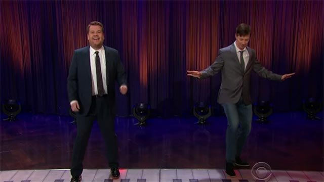 "James Corden & Sean Hayes performed on a giant floor piano during ""The Late Late Show with James Corden"" (Credit: The Late Late Show with James Corden / YouTube)"