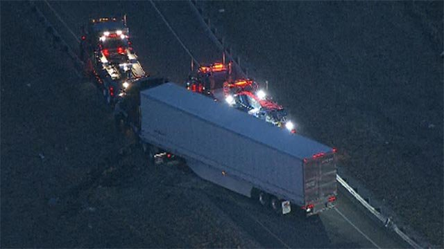 The tractor trailer overturned on the ramp in Collinsville before 5:40 a.m.