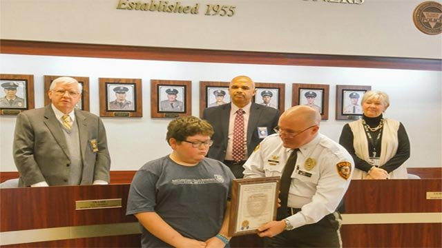 Blake Hohman was honored by the St. Louis County Police Department for his brave actions that saved his mother's life. (Credit: St. Louis County Police / Twitter)