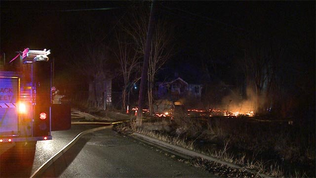 The flames were mostly contained to the backyard of a home on the 4800 block of Hallows Avenue.