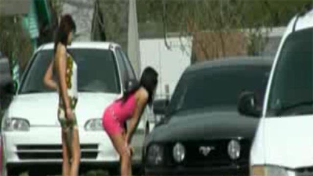 Unidentified women approaching a vehicle (Credit: KMOV)