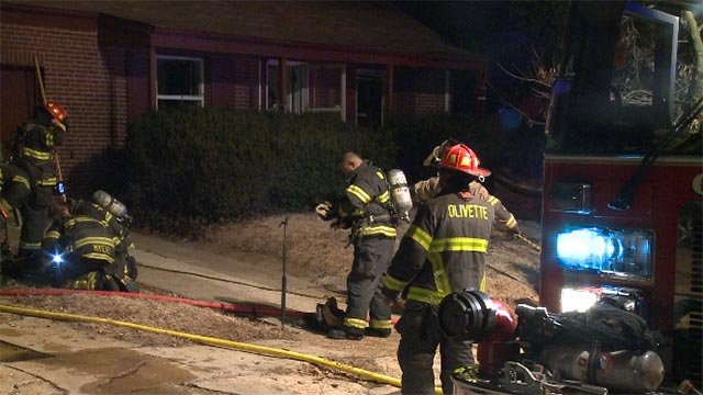 A firefighter was overheated while battling a blaze in the 1100 block of Collingwood Drive around 1 a.m. Friday (Credit: KMOV)