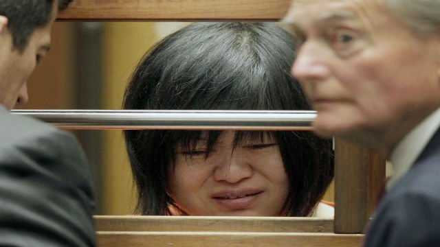 """Dr Hsiu Ying """"Lisa"""" Tseng cries during her arraignment, flanked by attornies, Edward Welbourn, left, and Alan Stokke, Friday, March 16, 2012 in Los Angeles. Tseng, a California doctor, has pleaded not guilty to charges of second-degree murder in the presc"""