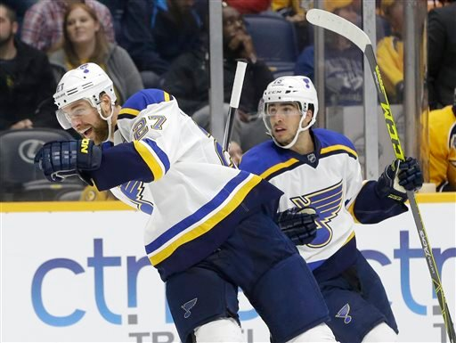 St. Louis Blues defenseman Alex Pietrangelo (27) and center Robby Fabbri (15) celebrate after Troy Brouwer, not shown, tipped in Pietrangelo's shot to score a goal against the Nashville Predators in the third period of an NHL hockey game. (AP Photos)
