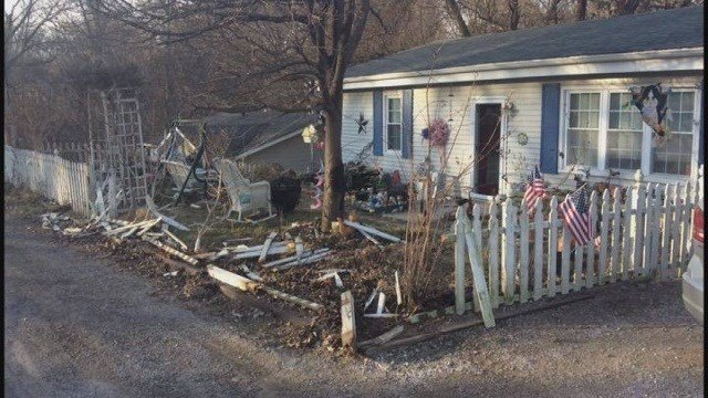 Damage after white SUV rammed into fence and mailbox (Credit: KMOV)