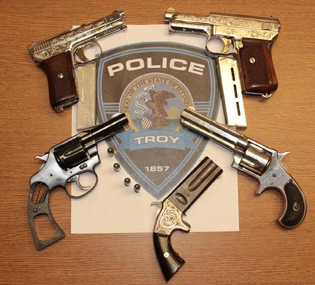 Six guns worth $10,000 were recovered by police in Troy, Ill. (Credit: Troy Police Department)