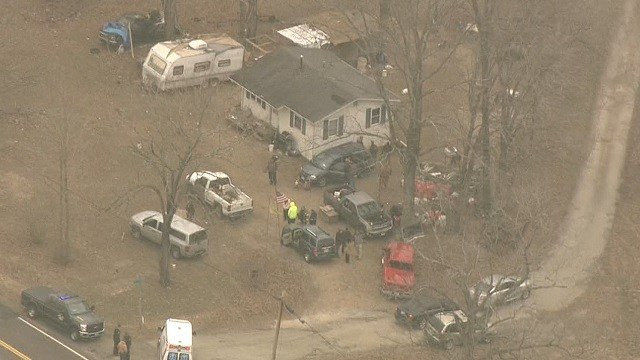 Police agencies around a van where the body of a missing toddler was found (Credit: KMOV)