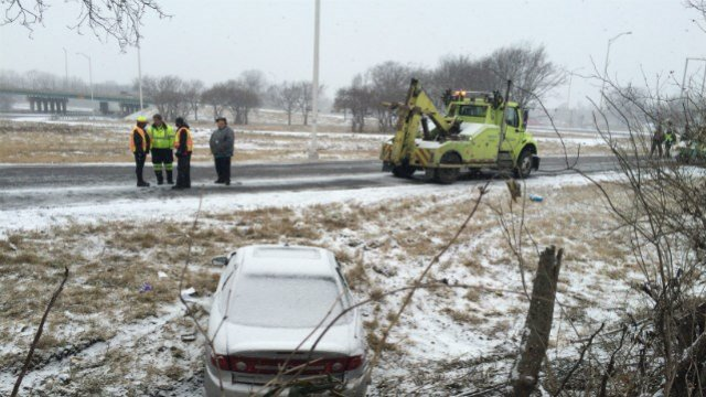 Two people, including an IDOT worker, were struck by a vehicle in Washington Park, Illinois Wednesday (Credit: Eric Voss, KMOV)