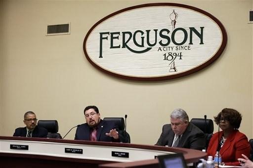 Ferguson mayor James Knowles III speaks during a city council meeting Tuesday, Feb. 2 in Ferguson. T(AP Photo/Jeff Roberson)