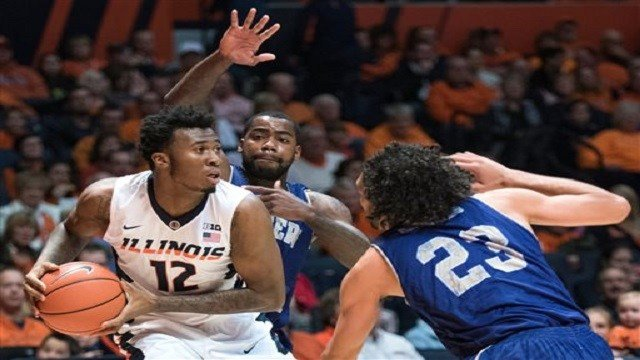 Illinois forward Leron Black (12) looks to pass while being guarded by Western Carolina forward Justin Browning (23) during an NCAA college basketball game in Champaign, Ill., Saturday, Dec. 5, 2015. (AP Photo/Robin Scholz)