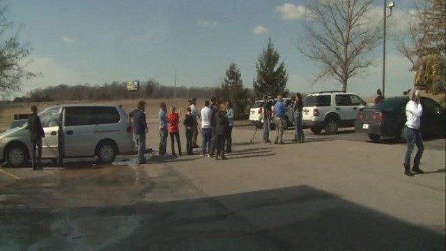 Workers collected in the parking lot. (Credit: KMOV)