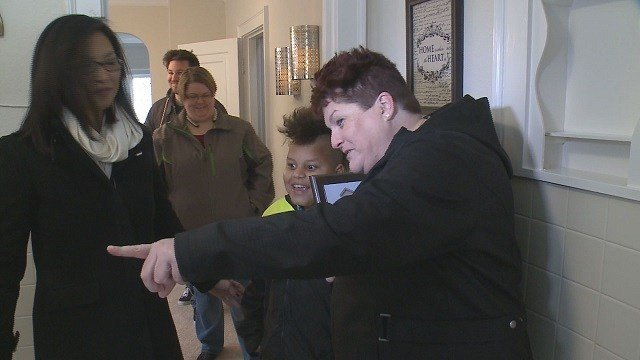 Sergeant Debra Millender was thanked for her service with a new house. (Credit: KMOV)