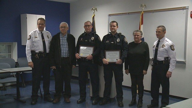 Wentzville Missouri Police officers Jason Smith (3rd from left) and Justin Houtz (4th from left) were awarded the Life Saving Award (Credit: KMOV).