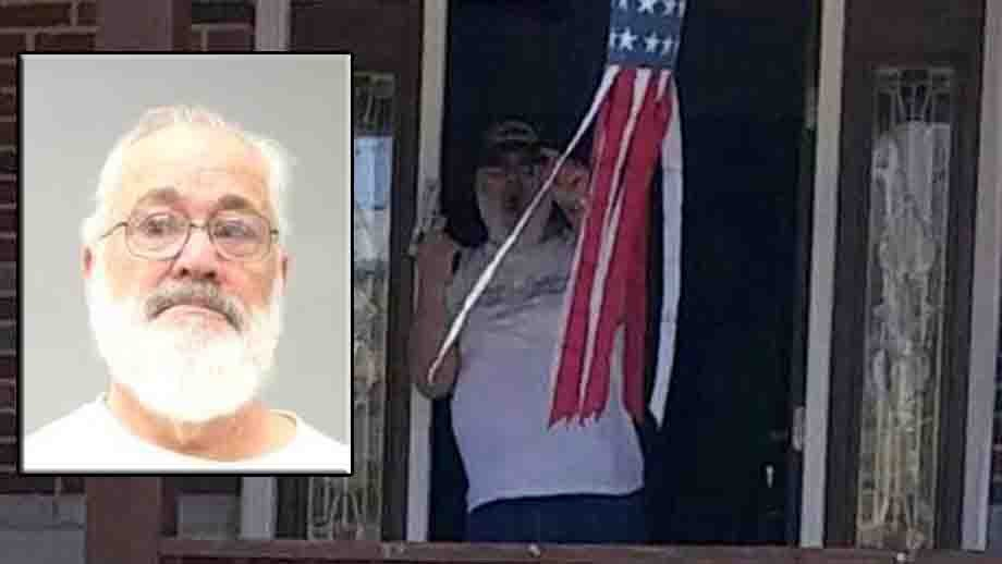 Leonard Debello seen with a gun on his front porch. (Photo provided by the family)
