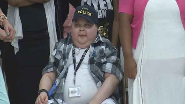 Officers give child with rare disease special award on graduation day