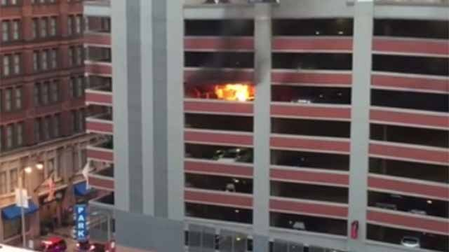 Car with family inside catches fire in downtown st louis for Cost to build a garage st louis