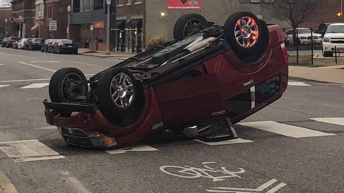 2 arrested after car flips over in accident in South City
