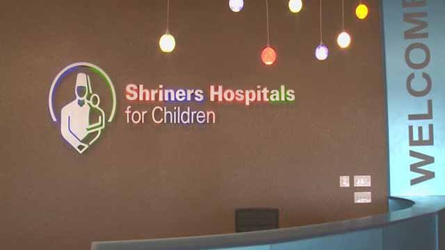 (Credit KMOV) & Metro Lighting holding toy driver for Shriners Hospital for Chil ... azcodes.com