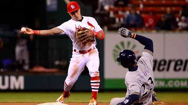 Kolten Wong #16 of the St. Louis Cardinals turns a double play as Keon Broxton #23 of the Milwaukee Brewers slides during the seventh inning at Busch Stadium on May 4, 2017 in St Louis, Missouri. (Photo by Jeff Curry/Getty Images)