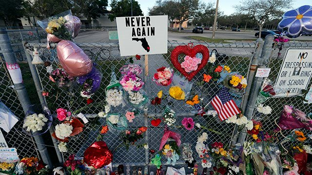 A makeshift memorial is seen outside the Marjory Stoneman Douglas High School, where 17 students and faculty were killed in a mass shooting on Wednesday, in Parkland, Fla., Monday, Feb. 19, 2018.  (AP Images)
