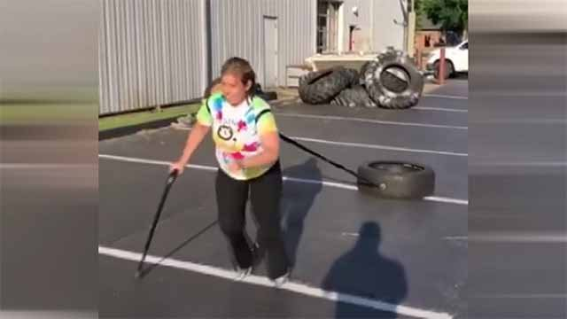 A video posted to Facebook shows Tiffany Eickhoff pulling a heavy tire several hundred feet across a parking lot. Credit: KMOV
