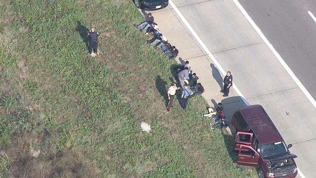 Multiple men on the side of the road in Eureka (Credit: KMOV)