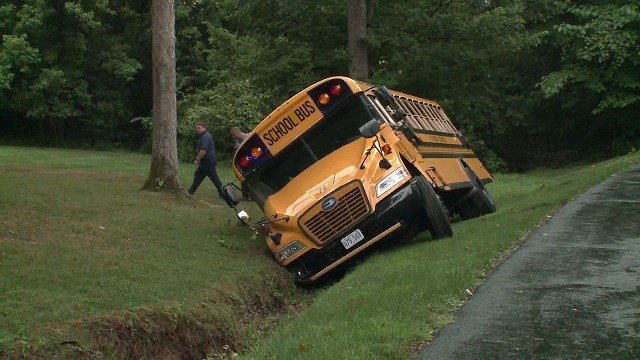 Emergency crews are on the scene after a school bus crashed in O'Fallon, Missouri Wednesday morning. (Credit: KMOV)