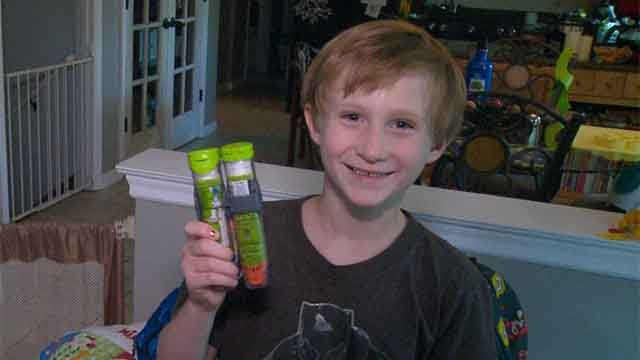 Nathan with an EpiPen. Credit: KMOV