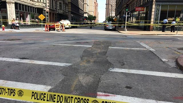 Crime scene tape on North 9th Street near Pine Street after a fatal shooting Friday (Credit: KMOV)