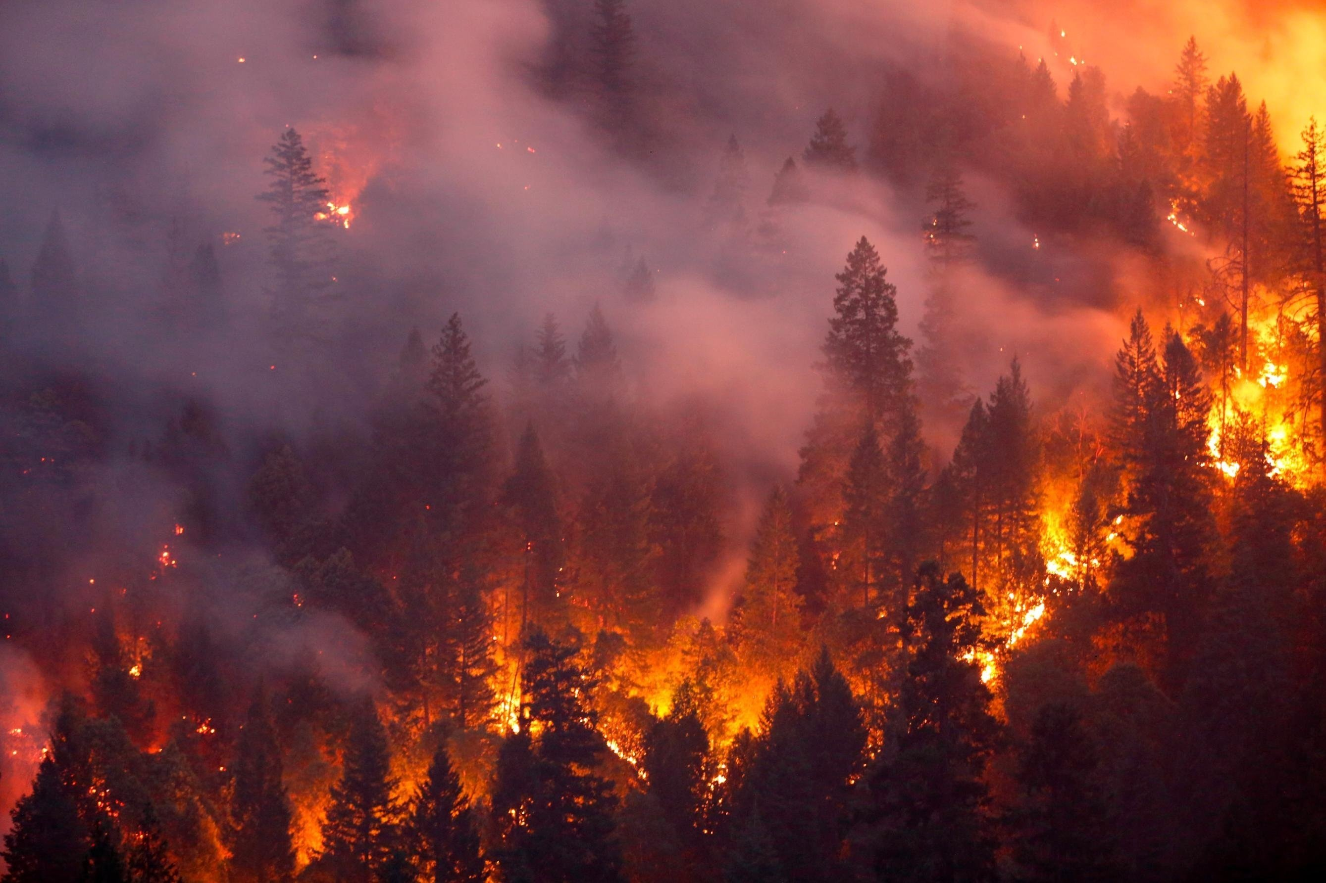 The winds raged, as fast as 165 mph, uprooting trees and ripping off roofs. Windows on firefighting bulldozers shattered as gusts inside the vortex hurled debris, rocks and embers. Temperatures inside likely exceeded 2,700 degrees Fahrenheit.  Getty/CNN